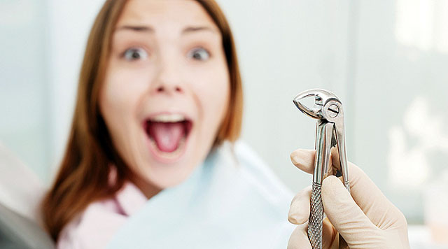 scared woman at dentist's office