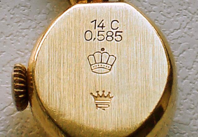 Наручний годинник з позначеннями проби по каратній і метричній системам